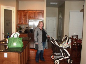 Kathy taking the just-assembled stroller for spin around the kitchen