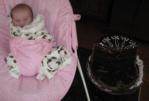 Grace's first birthday cake; 1week old! ...uhh, and already some cake missing