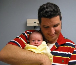 In the check-up room:  Dad and Grace wait a few minutes for the doctor